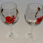 Rødvinsglas med valmuer. Pris: 125,- kr.